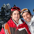 Two men about to ski - Stock Photo