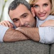 Stock Photo: Couple leaning on a sofa