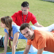 Group doing push-ups in park — Stock Photo #11025613