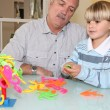 Stock Photo: Grandfather playing with grandson