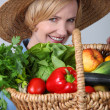 Stock Photo: Woman with basket of vegetables