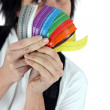 Female electrician holding much-colored cable ties — Stock Photo #11026734
