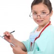 Portrait of a little girl dressed as a nurse — Stock Photo