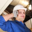Manual worker inspecting air-conditioning system — Stock Photo #11026859