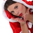 Stock Photo: Female SantClaus blowing kiss