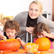 Mother and child preparing pumpkin — Stock Photo #11027144
