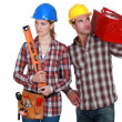 Foto Stock: Male and female builder