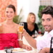 Stock Photo: Couple toasting in restaurant