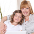 Mother with daughter and computer — Stock Photo