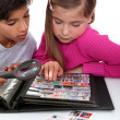 Stock Photo: Kids collecting stamps