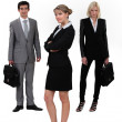 Young executives in different positions — Stock Photo #11029835