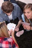 Teen playing cards — Stock Photo
