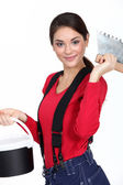 Female plasterer holding tool — Stock Photo