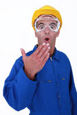 Shocked manual worker wearing safety glasses — Stock Photo