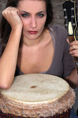 Woman with a bongo and guitar — Stock Photo