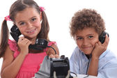 Two children using an old telephone — Stock Photo