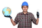 Worker with bulb and globe — Fotografia Stock