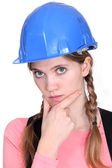 A pensive female construction worker. — Stock Photo