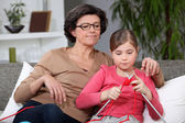 Knitting Grandmother and granddaughter — Stock Photo