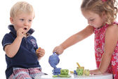 Two children playing at tea parties — Stock Photo
