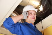 Manual worker inspecting air-conditioning system — Stock Photo