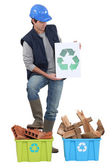 Builder stood by materials to be recycled — Stock Photo