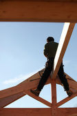 Builder sitting on a beam — Stock Photo