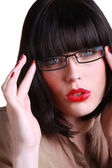 Attractive brunette wearing glasses — Stock Photo