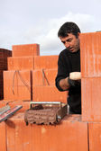 A bricklayer busy at work — Stock Photo