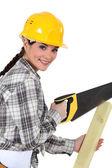 Woman sawing plank — Stock Photo