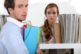 Colleagues surrounded by file folders — Stock Photo
