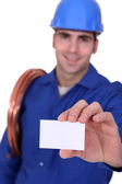 Plumber with a businesscard — Stock Photo