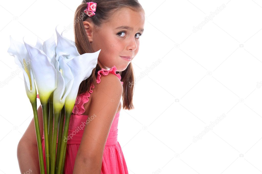 Little girl hiding flowers behind her back — Stock Photo #11025455