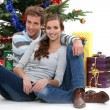 Стоковое фото: Happy couple celebrating Christmas