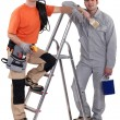 Painter and electrician stood by ladder — Stock Photo