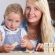 Stock Photo: Mother playing with daughter