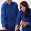 Experienced tradesman training his new apprentice — Stock Photo