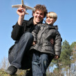 Father and son about to launch a toy plane - 