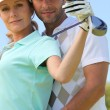 Couple with golf club — Stock Photo