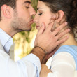 Stock Photo: Man kissing woman's nose