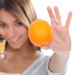 Woman drinking a fresh orange juice — Stock Photo
