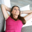 Woman lying on a sofa — Stock Photo #11031979