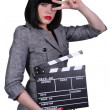Stock Photo: Womwith movie slate