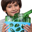 Boy with empty bottles — Stock Photo