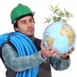 Plumber holding globe — Stock Photo
