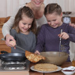 Family cooking pancakes — Stock Photo #11032294