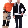 Businessman and craftsman posing together — Stock Photo