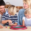 Stock Photo: Parents playing with children