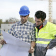 Stock Photo: Foremand colleague checking construction progress