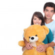 Teenage couple with a large stuffed bear — Stock Photo #11033067